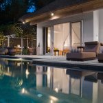 Poolside bedrooms and dining