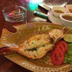 Choose fresh seafood at the restaurant in the evening by weight and have it cook your style