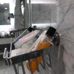 Broken toiletries shelf in shower
