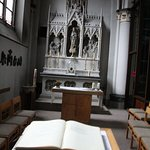 A side altar with comfy chairs