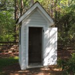 The old two seat outhouse next to the residence,
