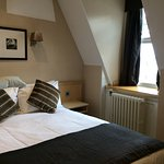 Sensitively restored bedroom