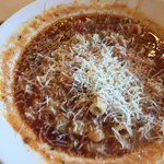Soup with fresh grated cheese