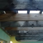 Black mold on the balcony of my room. You can see the boards they changed, for which they woke m