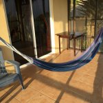 Cabins have hammocks in enclosed porches