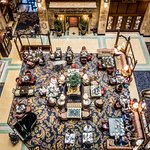 Guests enjoying afternoon tea in the Brown Palace lobby.