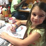 My older daughter coloring her picture, provided by the restaurant.