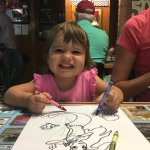 My younger daughter coloring her picture, provided by the restaurant.