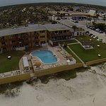 Beach side aerial view of the property