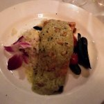 Grilled Faroe Salmon with a pesto cream, toasted pine nuts, artichoke risotto, chef's vegetables