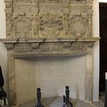Stone carved fireplace.