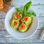 Spaghetti tossed with our housemade creamy basil pesto sauce