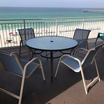 New furniture and huge patio with views of the beach, pier and pool