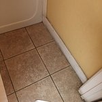 filthy tiled floor and wall trim
