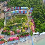 Aerial view of resort and Samae Beach. Colourful and cheerful buildings.