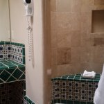 Attractive & clean shower but no door.