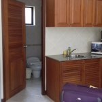 The fully equipped kitchenette with an electric stove, fridge, microwave, crockery and cutlery