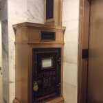 Cool old fashioned mail chute box near lobby