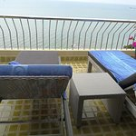 chaise lounges on balcony to enjoy the sea view