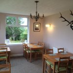 Our sun lounge, a dining area just off the bar