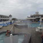 Two of the hot tubs and the outdoor pool w/restaurant building in background