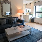 Lounge and kitchenette at Princes St Suites