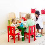 Playing with the play kitchen