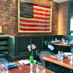 A 45-star American Flag from 1896 hangs in our café, upon brick that is just about the same age.
