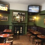Recently refurbished bar/seating area with various TV's showing all the live sports on a daily b