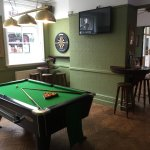 Recently refurbished games room including dart board, pool table and fruit machines.