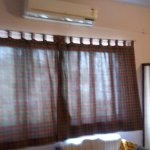 siiting area within the room.you have a convenient 2 seater and a small teapoy (indian desk)