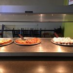 All You Can Eat & Made To Order Pizza Salad Cheese Bread & Cinnamon Bread Only $7.99