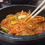 Hot Stone Bibimbap with sweet potato noodle, vegetables and tofu