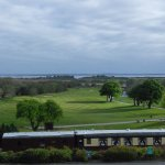 Beautiful view of train,golf course, and lake