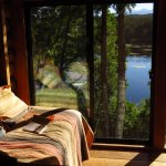 The Bungalow Cabin overlooking the lake from sunroom
