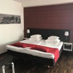 Comfortable firm bed and faux hardwood floors