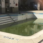 Poorly maintained outdoor swimming pool