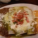 Shredded beef enchilada with chile verde sauce