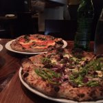 Foreground: Smoked Pork Pizza and Background: Margherita Pizza
