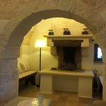 3-room trulli suite - view from living room into fireplace/sitting nook.