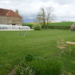 Swimming pool, large garden with swingset, soccer goal and table/chairs