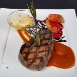 Filet mignon with four chiles sauce and sweet potato puree.