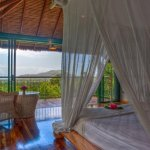 Bedroom and  balcony with view to the Rainforest… Handcrafted king sized bed.