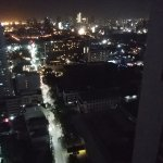View rom the 30th floor of the adjacent hotel overlooking Manila at night.
