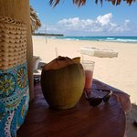 Tropical drinks under a beach palapa and awesome view of the ocean