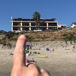 We are on the beach he is pointing to our room 2nd floor 2nd room in