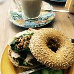 Bagel with smoked chicken ham and pesto