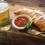 Calzone w/ homemade marinara and Pedernales Beer!  Yum!