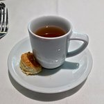 Complimentary starter - chicken broth in a tiny cup