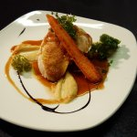 Grilled Supreme of Chicken, Roast Garlic & Onion Puree, Caramelised Carrots,Crispy Kale.